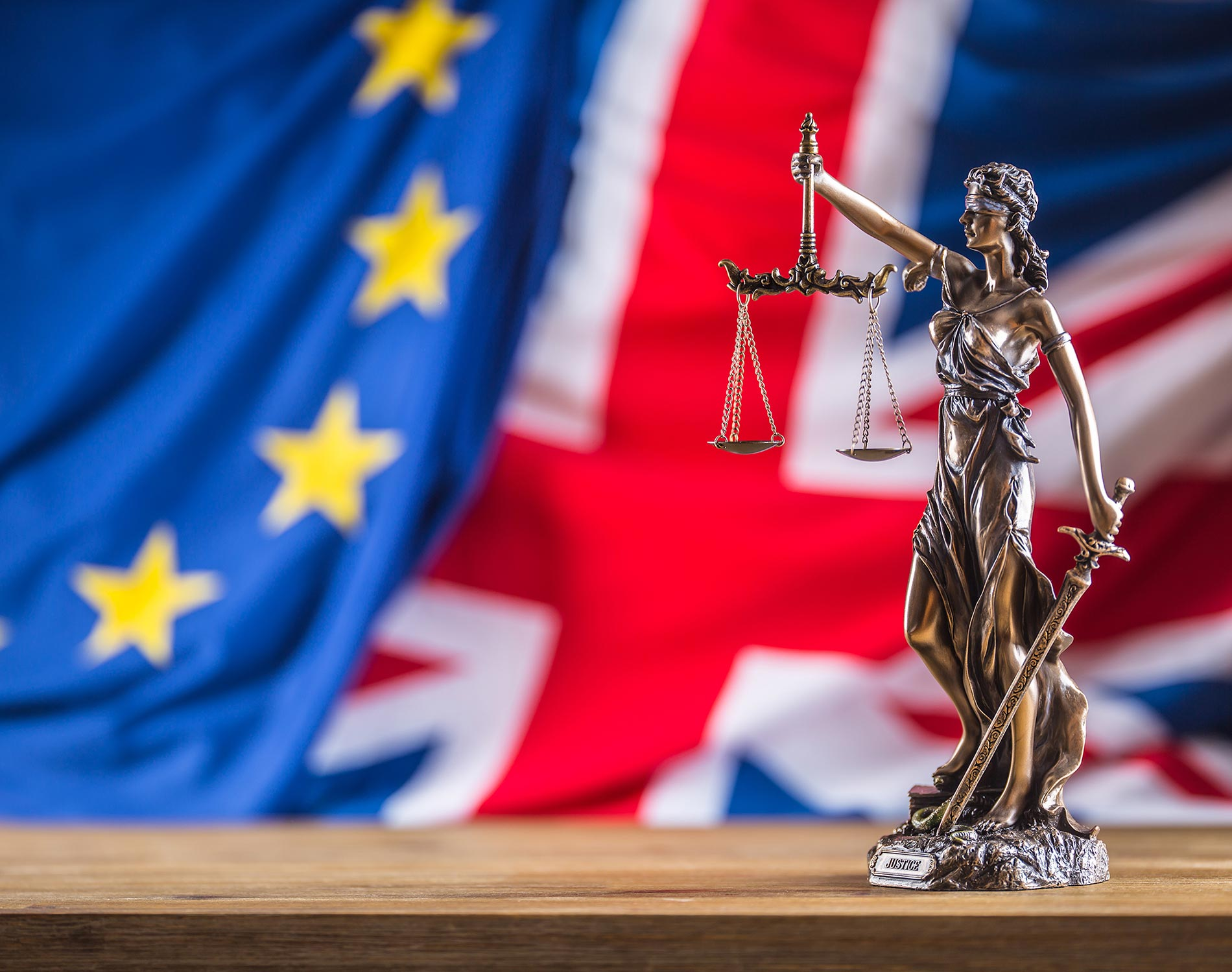 Symbol of law and justice with EU and UK Flag