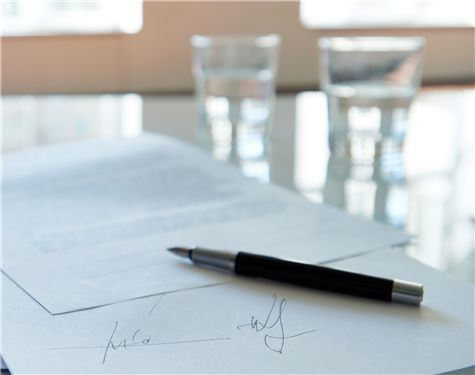 Signed document on table
