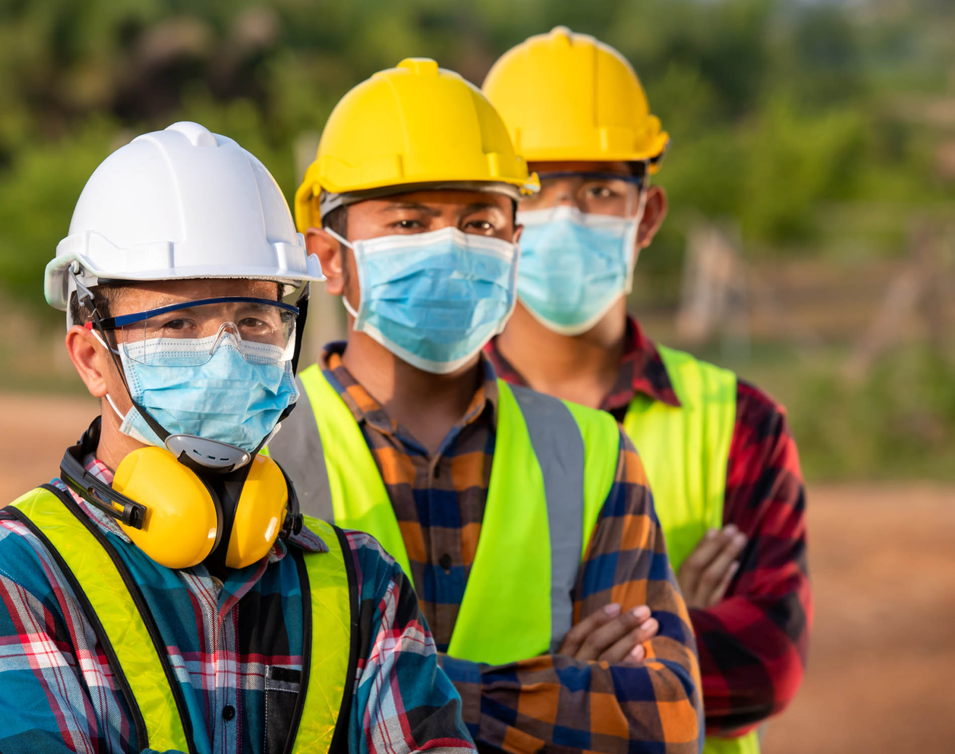 Workers wearing masks